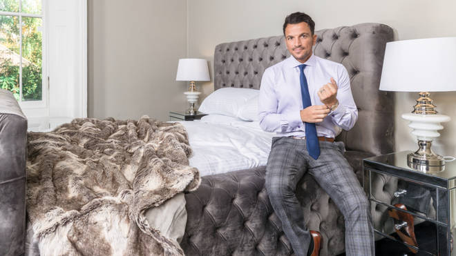 Peter Andre sits on one of the new beds he has designed