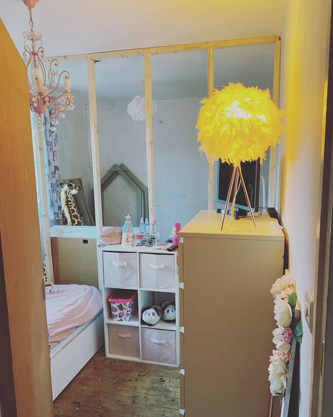 A stud wall split one room in to two for her baby son and her daughter