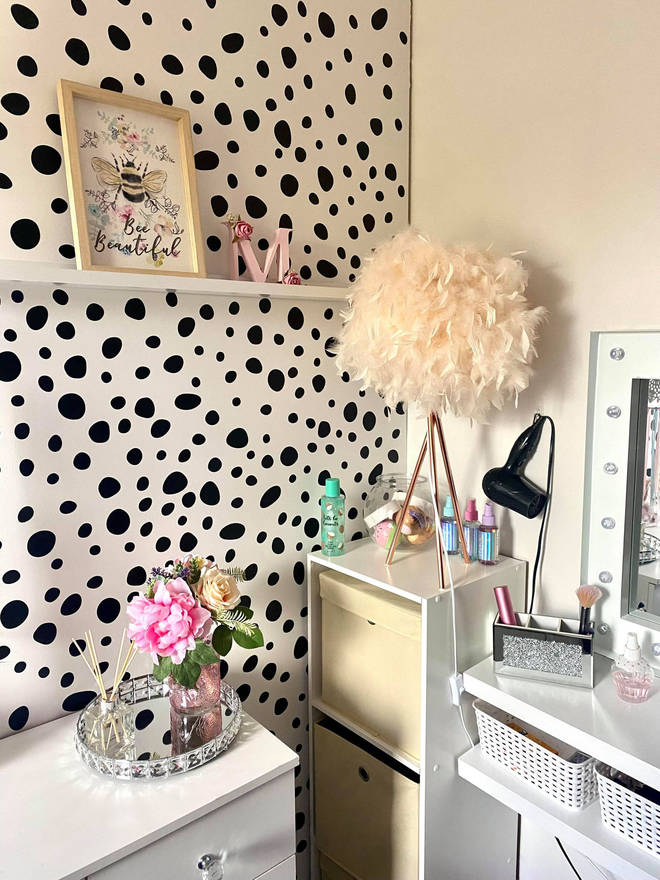 Her daughter's room is a girly haven with trendy polka dot walls