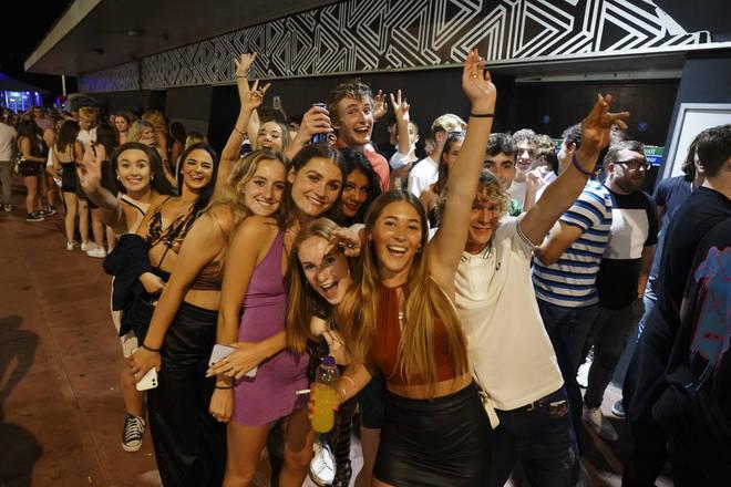 Revellers queue outside Pryzm nightclub in Brighton