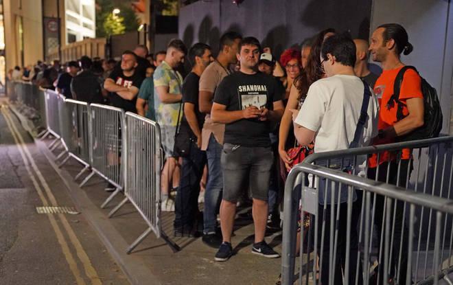 People queue outside EGG nightclub in London