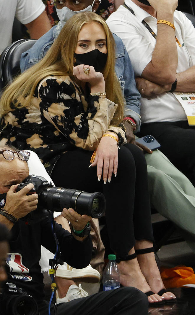 Adele showed off her new long locks as she sat in the crowd of the NBA Finals on Saturday night