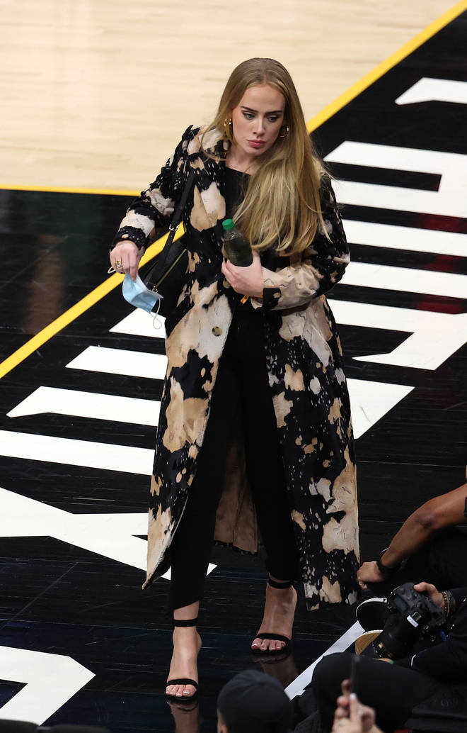 Adele wore black trousers teamed with a black top, black stilettos and a statement jacket