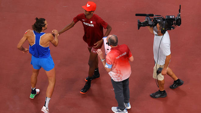 After the official told the athletes that two gold medals was possible as long as they both agreed, they began to celebrate
