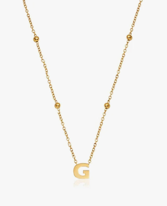 This classic initial necklace will soon become your staple go-to