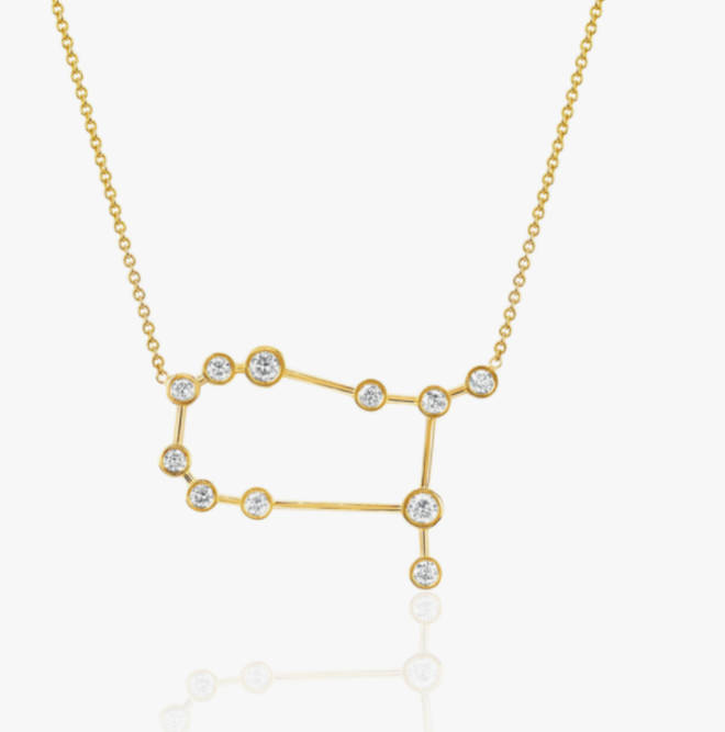 The necklaces are the star constellations for Gemini and Taurus, her children's star signs