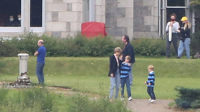 The two boys cast as William and Harry wore matching rugby shirts and jeans