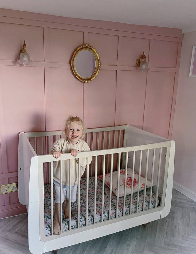 The pink panelled walls are a stunning addition to the room