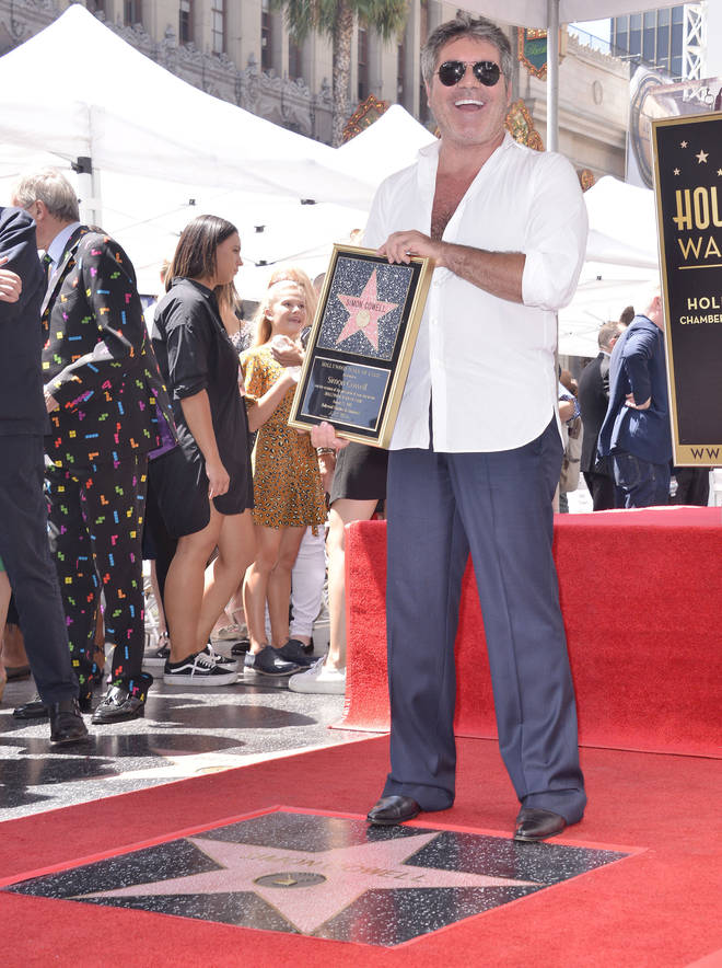 Simon Cowell receiving his star on the Hollywood walk of fame