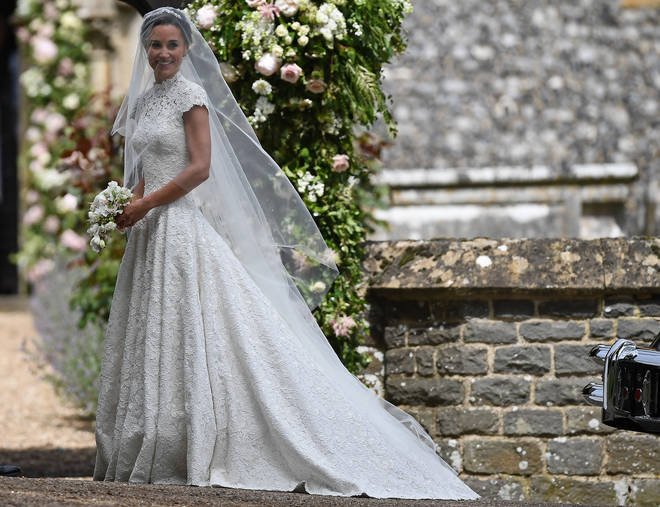 Pippa Middleton smiles to the cameras moments before her wedding to James Matthews