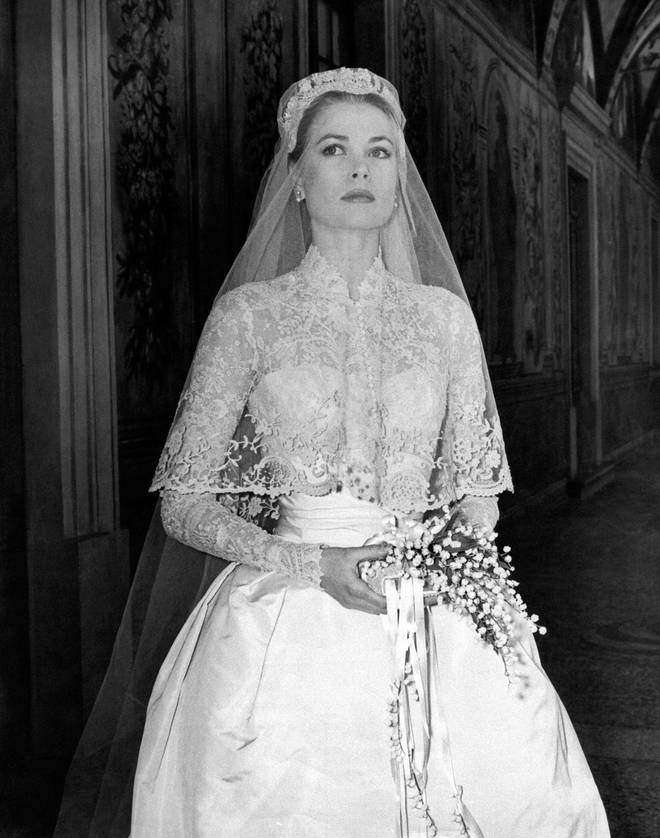 Grace Kelly poses in her wedding gown in 1956