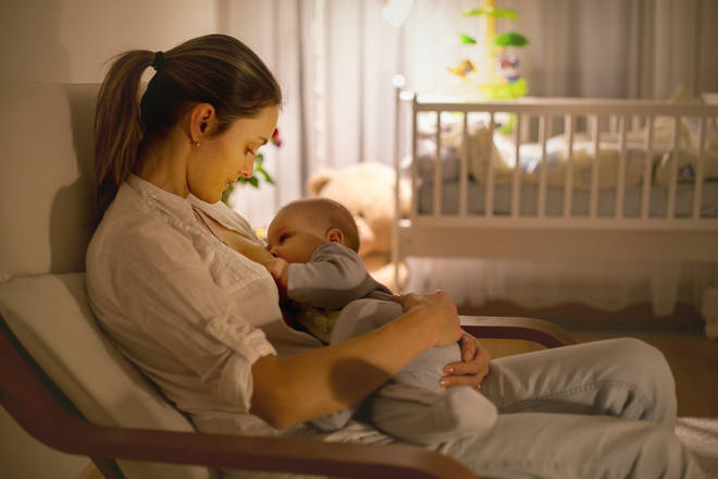 His partner wakes up at night to feed the baby (stock image)