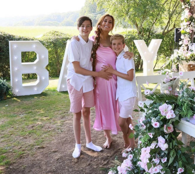 Stacey Solomon's sons, Leighton and Zachary, lovingly cradle their mum's baby bump