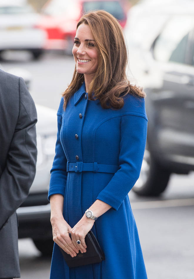 Kate keeps a compact mirror, along with three other items, in her handbag