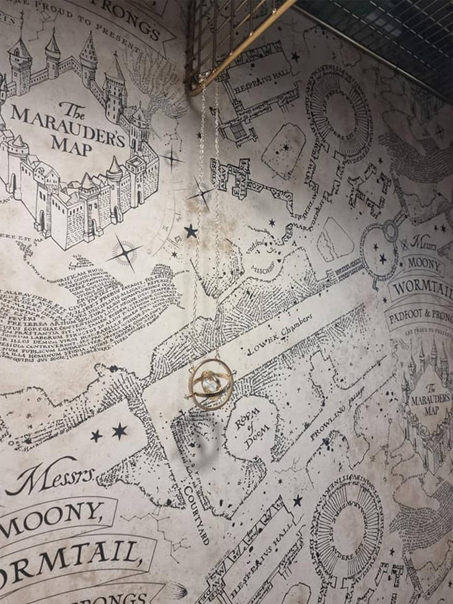 The walls are covered in Marauder's Map wallpaper