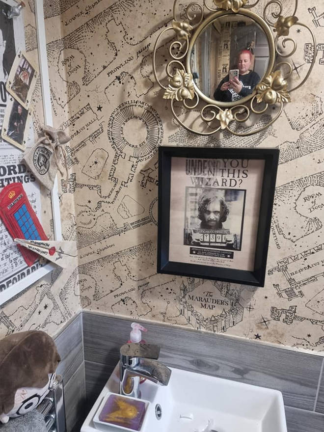 The bathroom features posted from the films