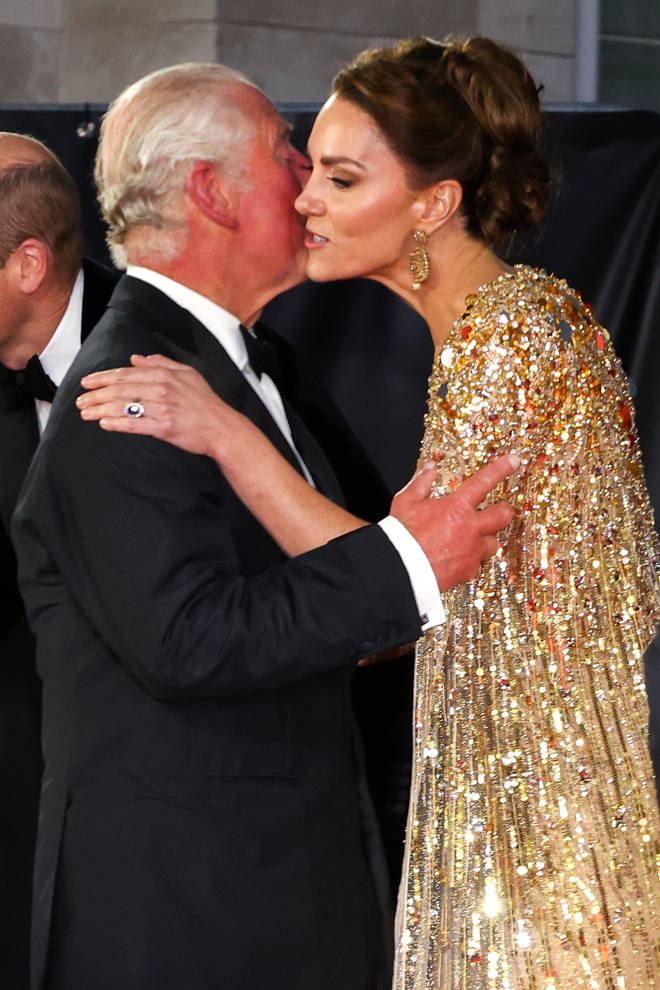 Kate Middleton and Prince Charles shared a kiss as they met on the red carpet of the premiere