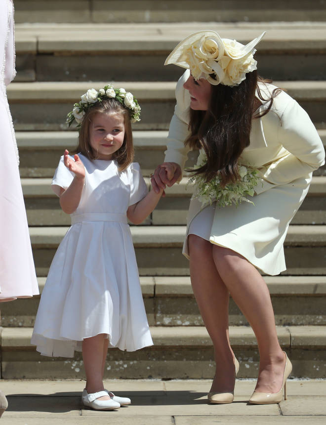 Kate encourages Princes Charlotte to wave during the Royal Wedding