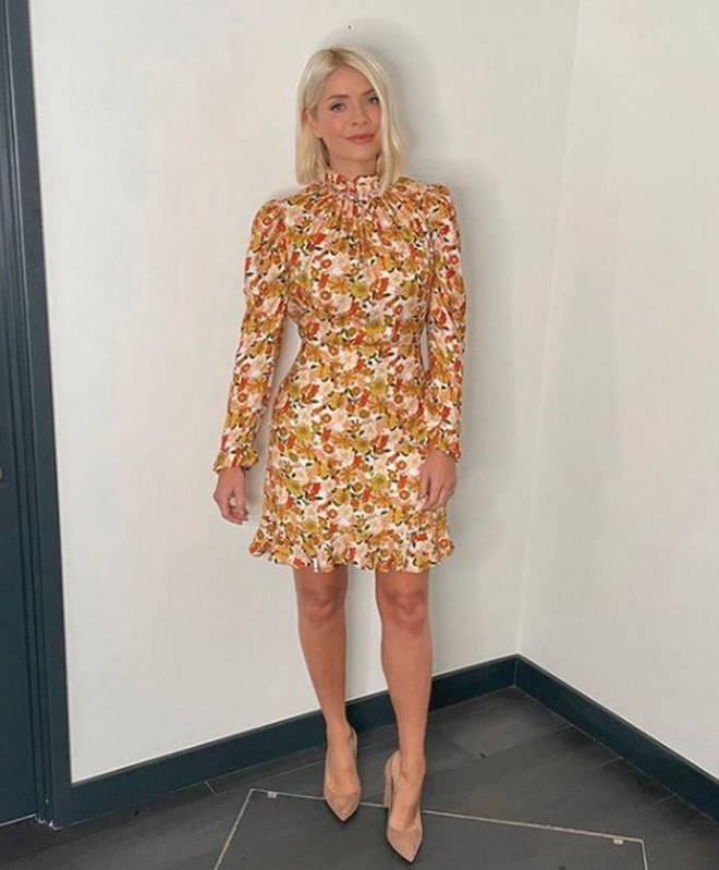 Holly Willoughby is wearing a yellow patterned mini dress on This Morning