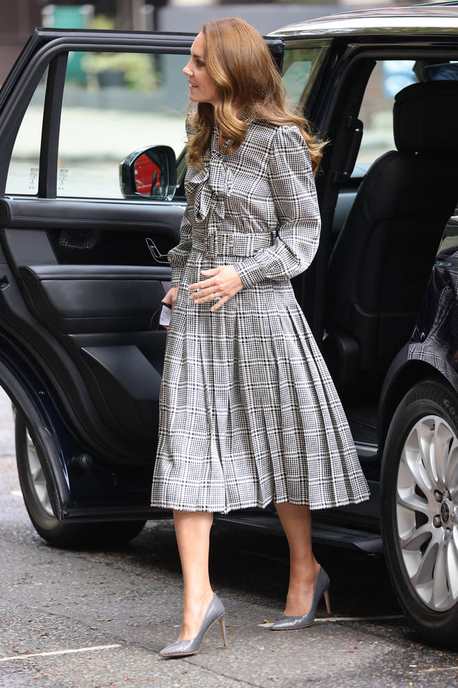 The Duchess of Cambridge teamed a checked dress with grey stilettos for the event in London