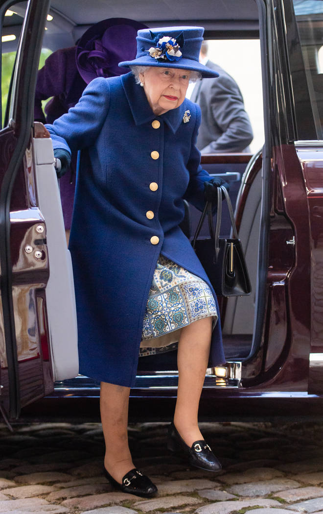 The Queen exited the car without the walking stick, but was later given it from her daughter Princess Anne
