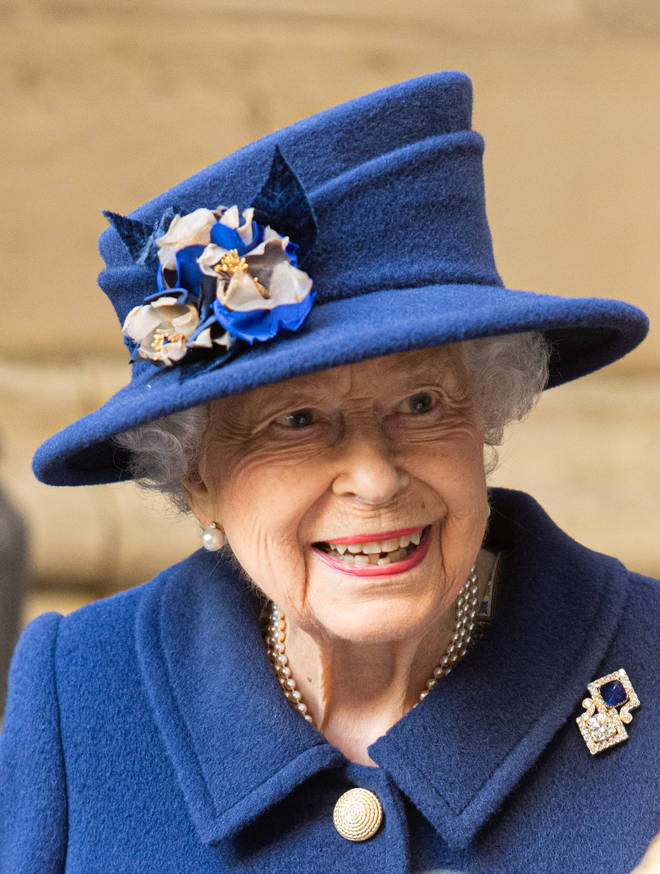 Her Majesty dressed in a blue coat and matching hat for the occasion