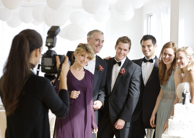 The photographer was originally invited to the wedding as a guest, but was denied food or a seat when she agreed to shoot the big day