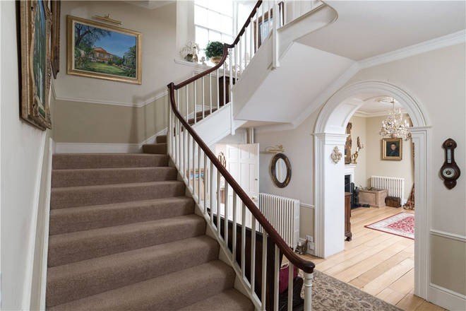 The property features a grand staircase