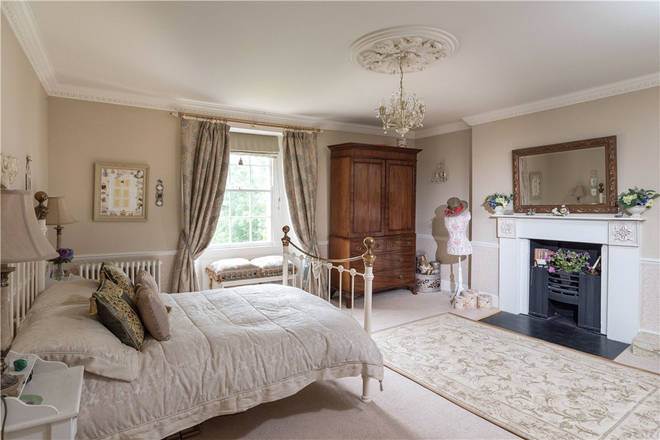 The bedrooms feature antique dressings