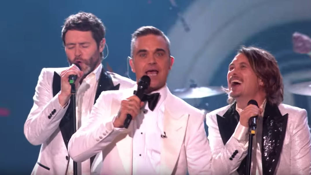 Take That fans go wild as Robbie Williams joins them for special X Factor performance