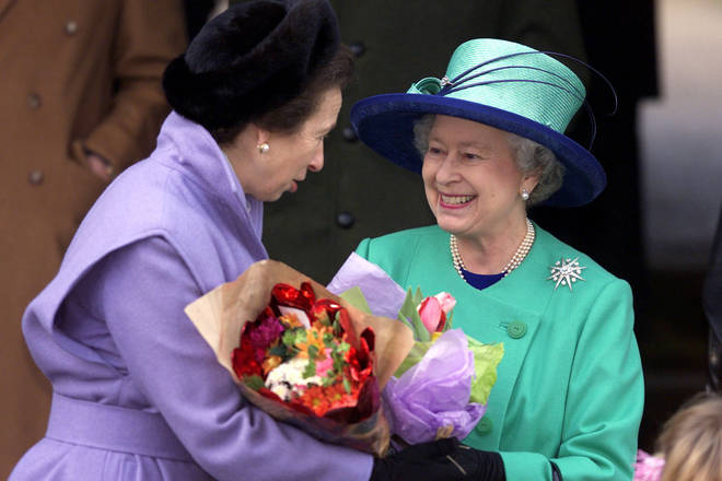 Princess Anna and the Queen hold flowers fro well wishers