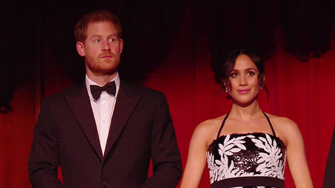 Meghan and Harry take their seats at the London Palladium