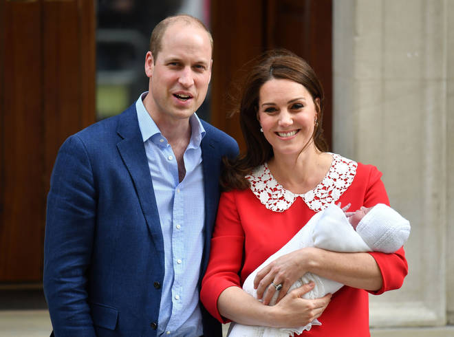 The Duke and Duchess of Cambridge smile with newborn Prince Louis