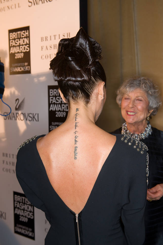 Victoria's Hebrew back tattoo in 2009