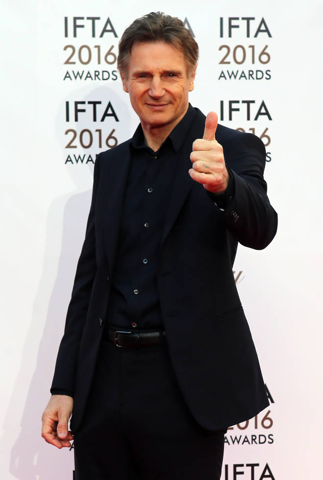 Liam Neeson poses on the red carpet