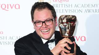 Alan Carr celebrating his BAFTA win