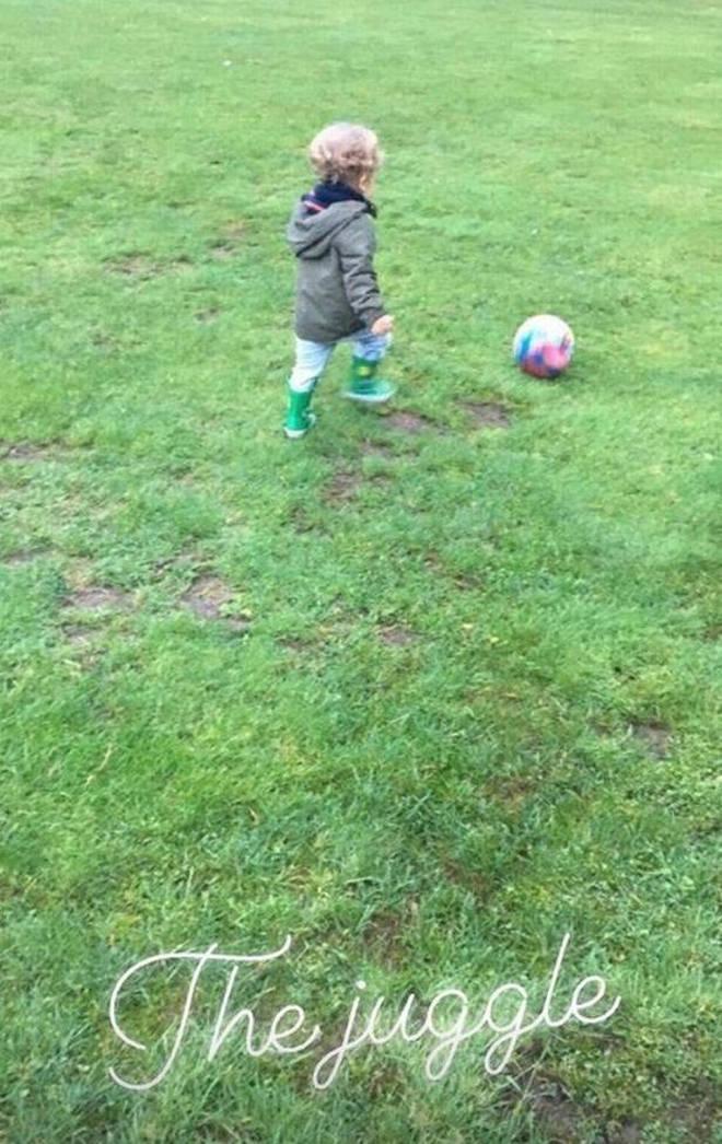 Cheryl shares snap of son Bear playing football