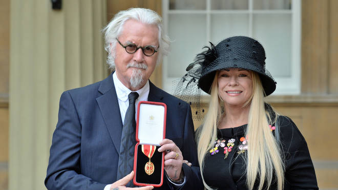 Billy Connolly and wife Pamela Stephenson after he was knighted by the Duke of Cambridge at Buckingham Palace