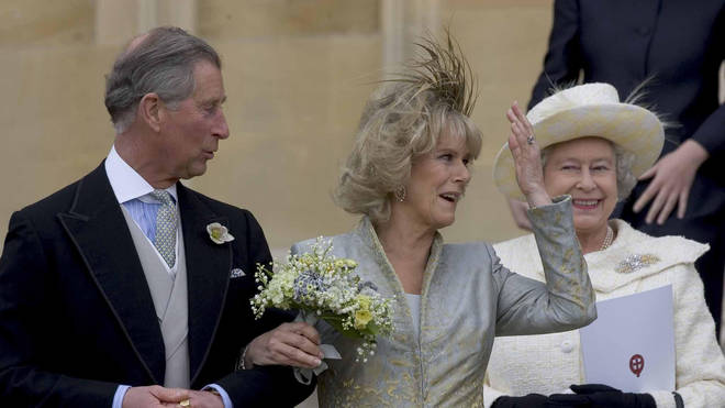 Prince Charles and Camilla leave St George's Chapel in Windsor after having their wedding blessed