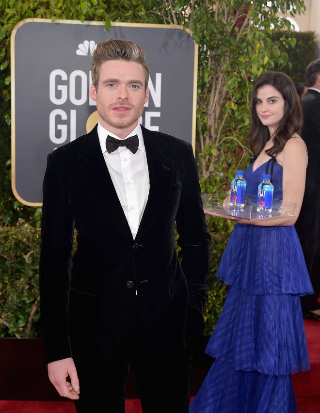 Fiji water girl photobombs at the Golden Globes