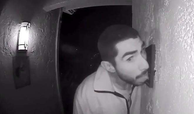 Roberto Daniel Arroyo was caught licking his neighbour's doorbell on CCTV