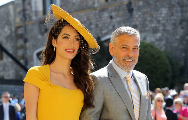 Amal and George Clooney at the royal wedding in May