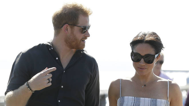 Meghan and Harry pictured early on in the pregnancy during their time in Australia