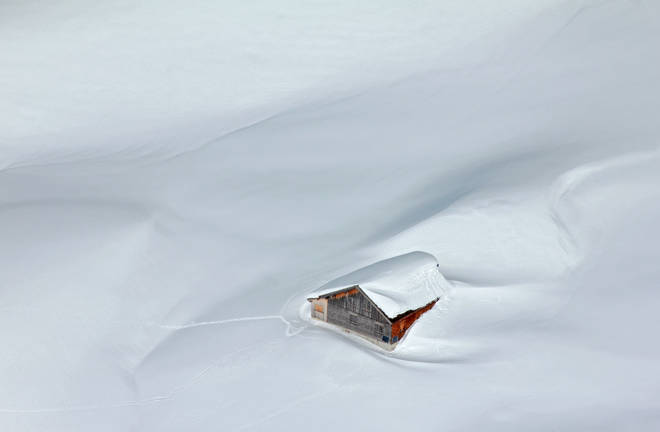 House covered in snow