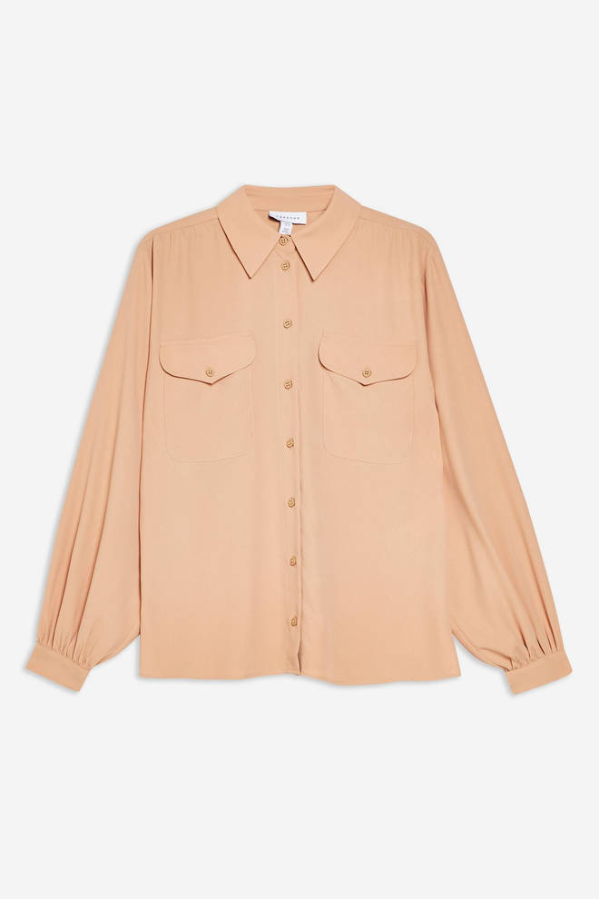 Kelly's neutral-toned shirt is from Topshop