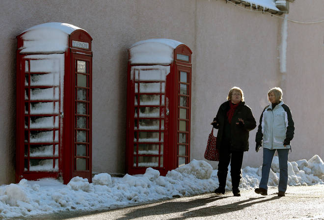 Snowy phone boxes in the Scottish Highlands
