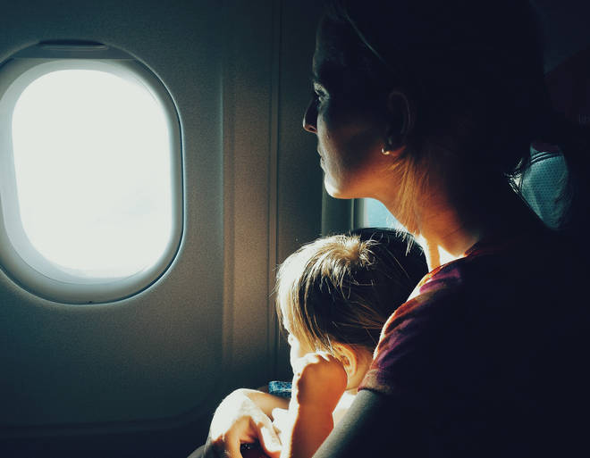 The mum was met by 'huffs and puffs' from a man when she boarded a plane with her toddler (stock image)