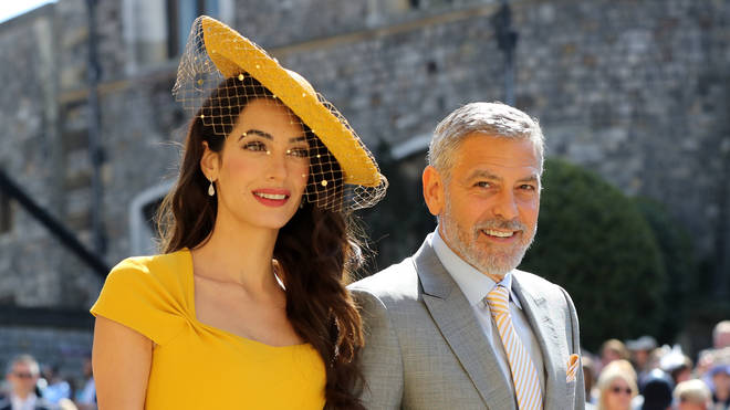 George and Amal Clooney at the royal wedding in 2018