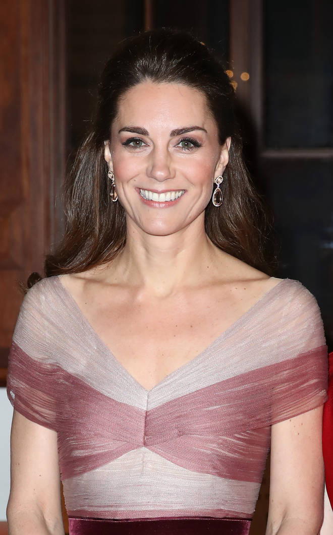 Kate Middleton wore her hair in a curl, with half pinned up