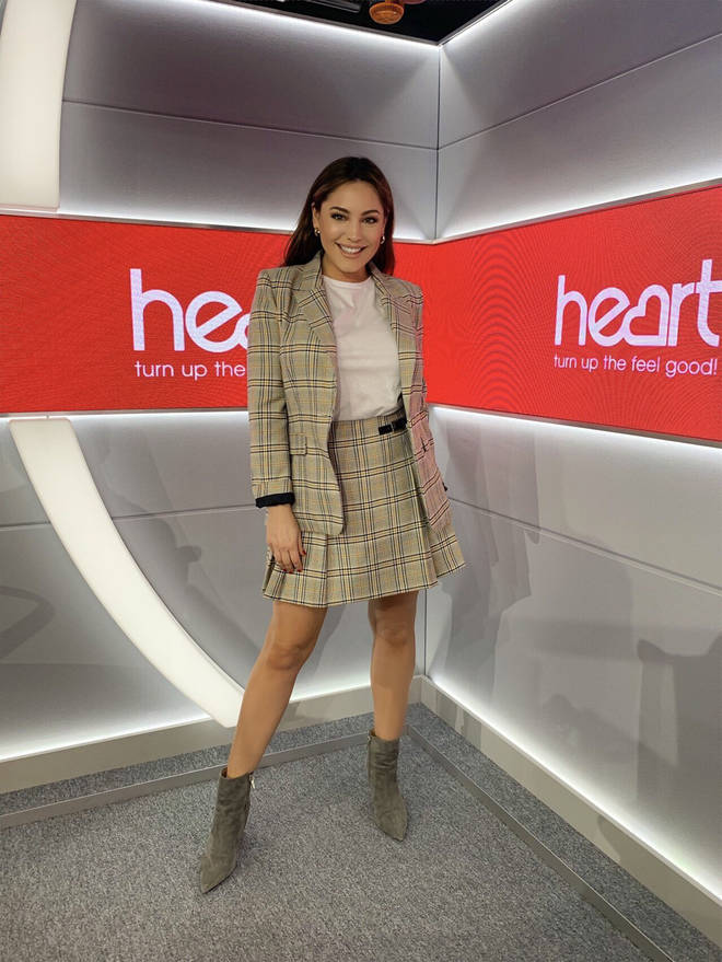 Kelly Brook arrived for work in am matching tartan kilt and jacket